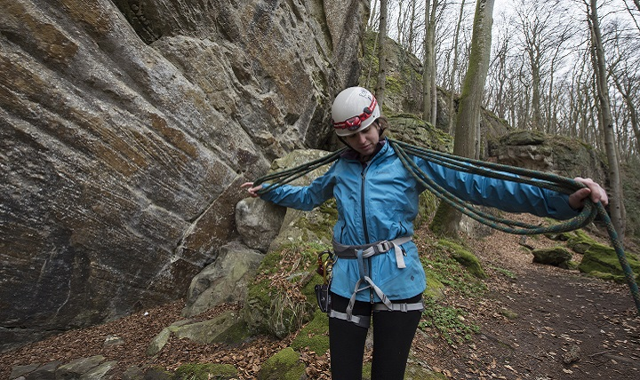 Hana Rice, a guide with U.S. Military Outdoor Recreation, secures a climbing rope after repelling from an approximate 35 foot rock face within the National Network of Footpaths in the Grand-Duchy of Luxembourg. Members of the climbing party were required to wear the appropriate climbing helmet and safety harness in order to prevent possible injuries such as traumatic brain injury. TBI awareness is observed throughout the month of March in hopes of spreading awareness of the trauma and potentially preventing future cases. (Air Force photo by Tech. Sgt. Brian Kimball)